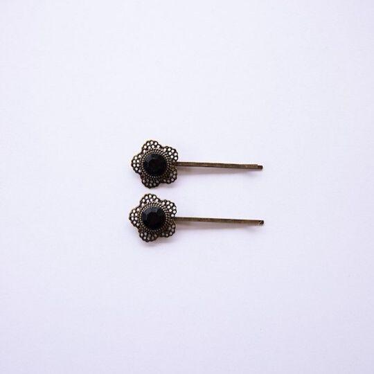 Horquillas negras en forma de flor